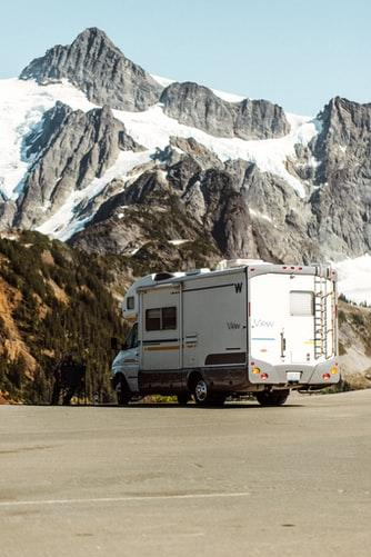 RV by snowy mountain